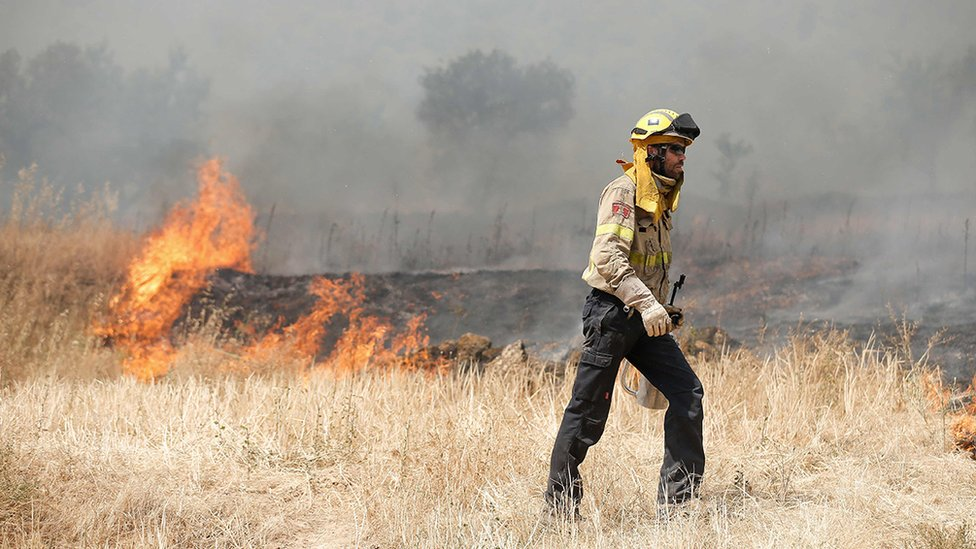 firefighter in catalonia wildfire