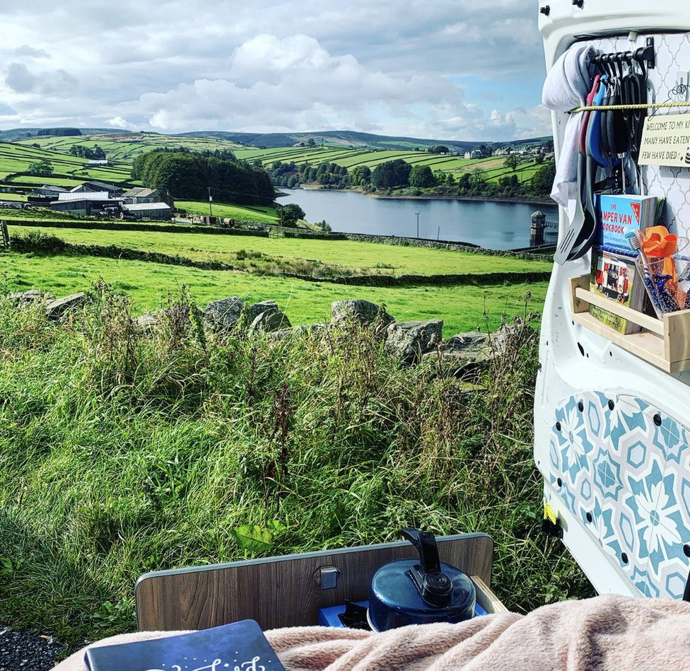 A view over the countryside from the back of a converted Berlingo