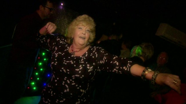Older woman dancing in a night club
