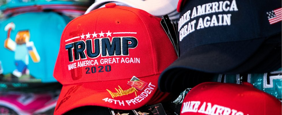 Trump 2020 caps are seen on display at a souvenir vendor in Washington, U.S., April 8, 2019