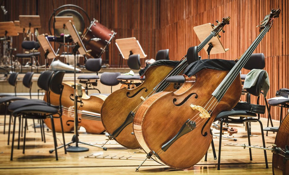 Orchestra instruments in a performance space