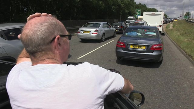 A frustrated driver looks at he traffic jam