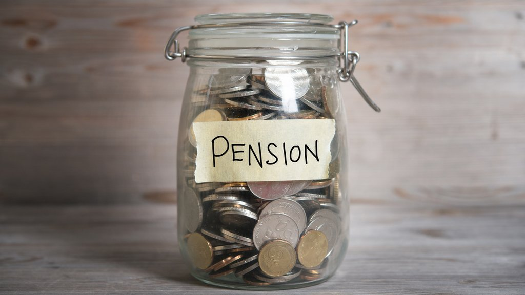 A jar of coins with a label saying pension