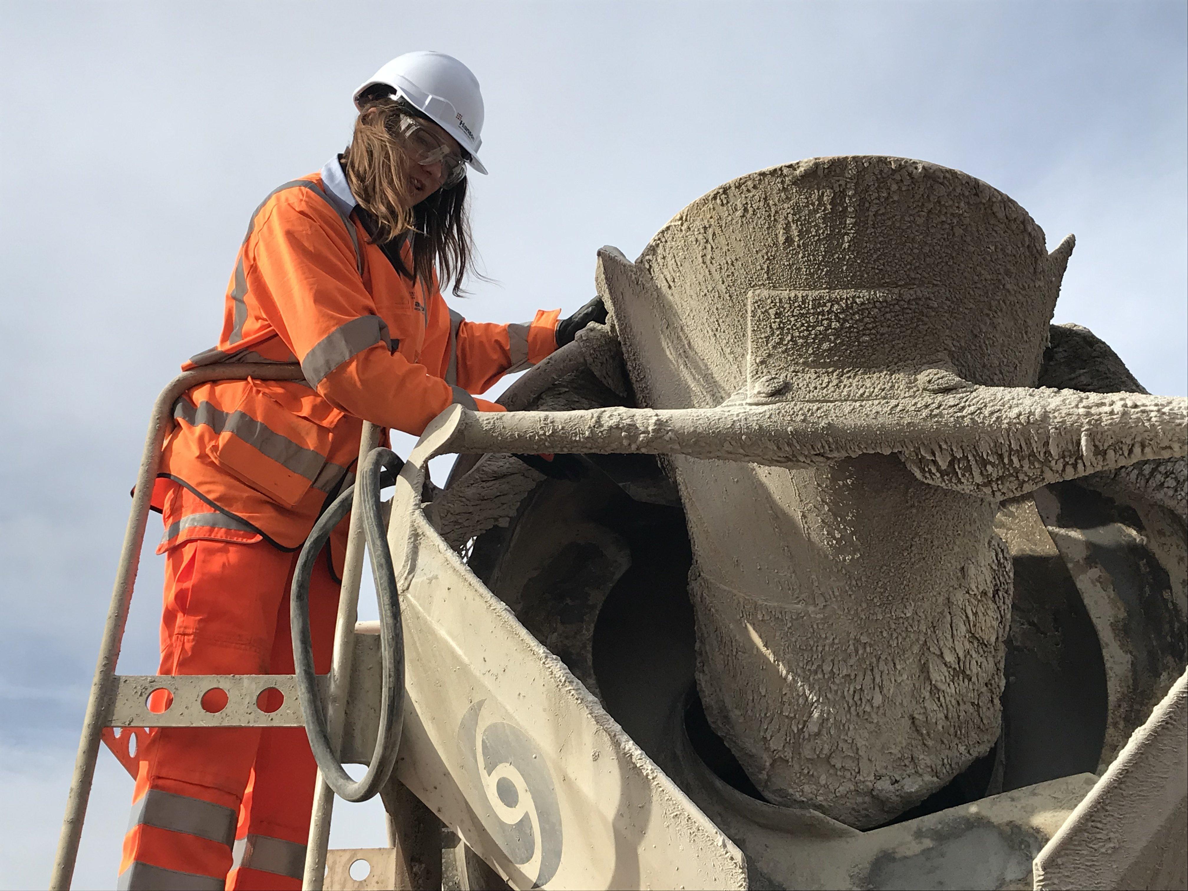 Emily Burridge inspects a batch of concrete