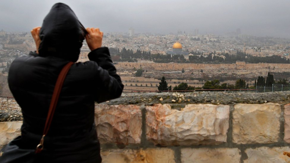 Person looks over at the Old City of Jerusalem on 6 December 2017