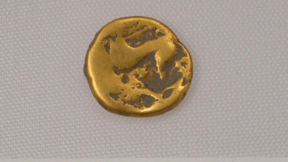 Moneda de oro de la Edad de Hierro.