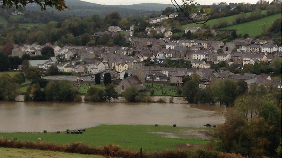 Swollen river at Llandysul, looking towards the community with the river in the foreground
