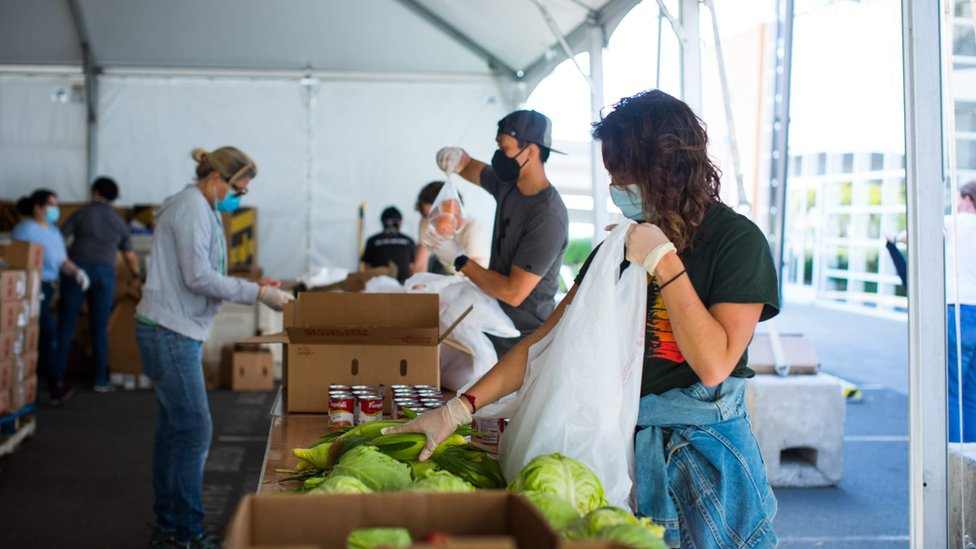 Volunteers pack bags of food at the San Francisco-Marin Food Bank