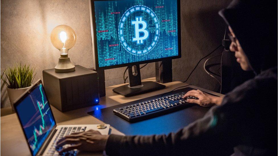 Man looking at Bitcoin screen