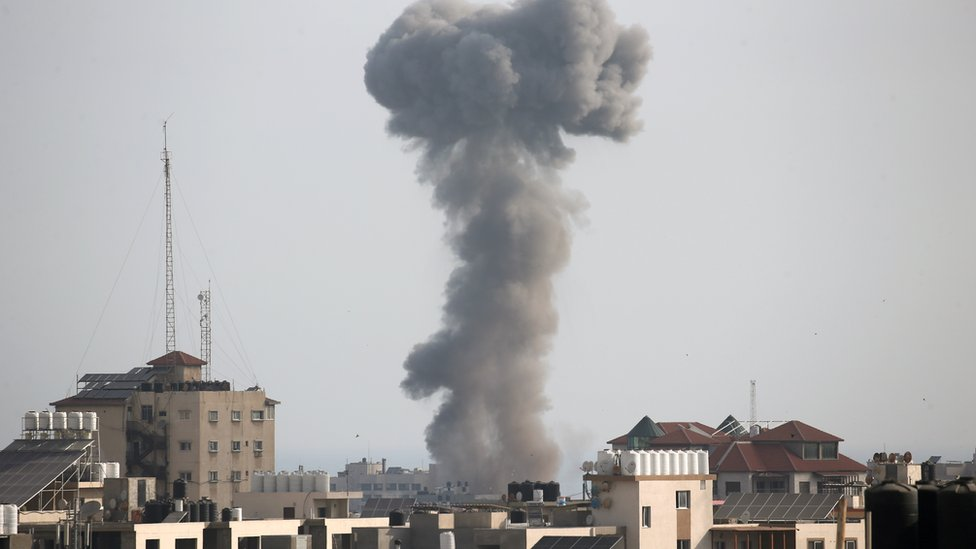 Smoke rises following an Israeli air strike, amid Israeli-Palestinian fighting, in Gaza, May 20, 2021.