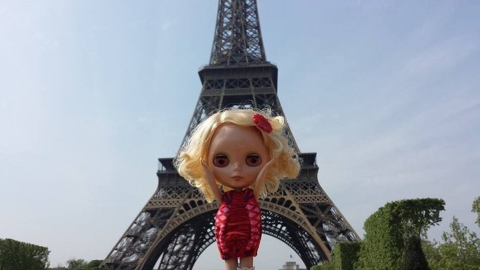 Blythe in front of the Eiffel Tower