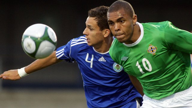 San Marino's Christian Brolli tussles with NI striker Josh Magennis in a World Cup qualifier in 2009