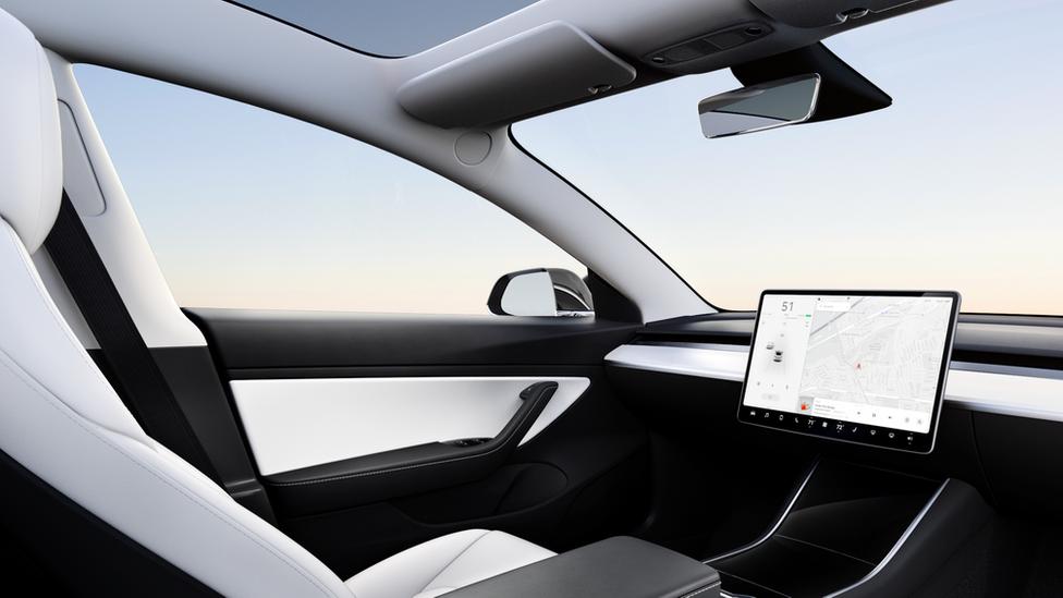 Interior of a model 3 Tesla with no steering wheel
