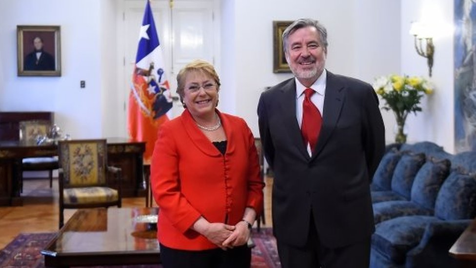 and out picture showing Chilean President Michelle Bachelet(L) posing with Alejandro Guillier candidate for the ruling New Majority coalition on Last Sunday national elections at La Moneda Presidential Palace in Santiago, on November 21, 2017.