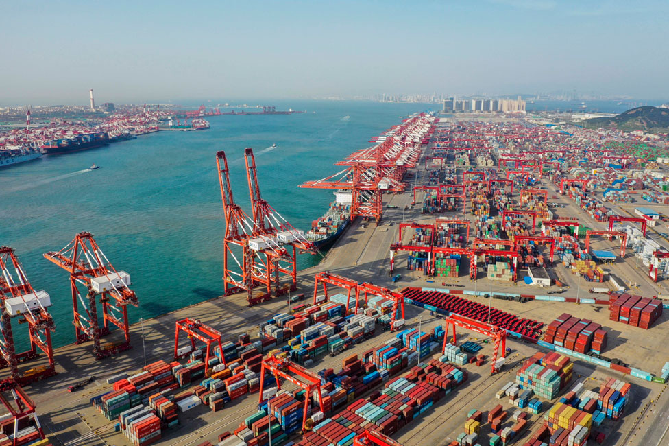 Aerial view of containers sitting stacked at Qingdao Port on 28 May, 2019 in Qingdao