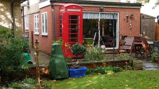 Telephone box in garden