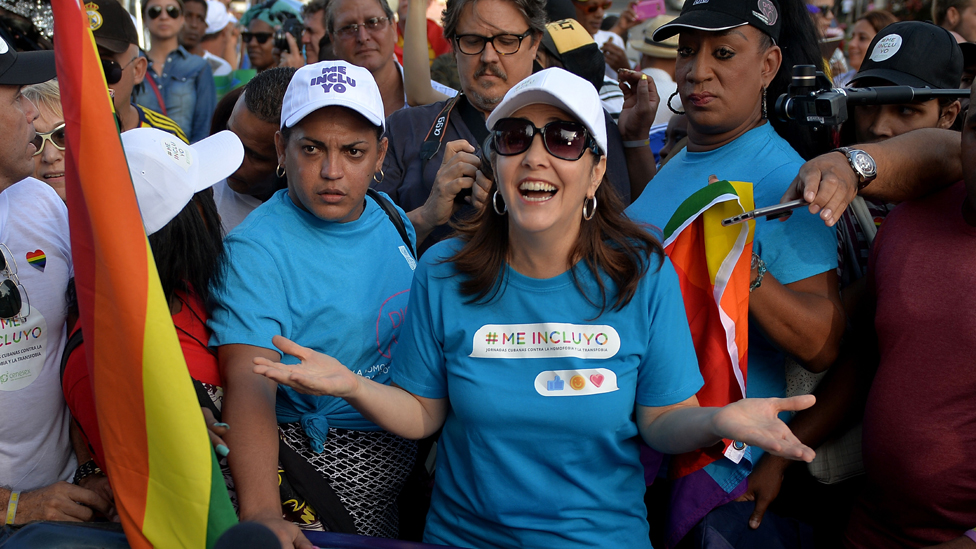 Mariela Castro (C), daughter of Cuban former President Raul Castro, participates in the gay pride parade during the celebration of the day against homophobia and transphobia in Havana, on May 12, 2018