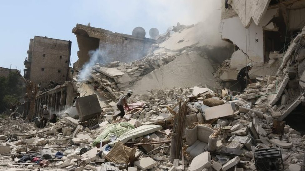 Syrian rescue workers search for victims through the rubble of a building destroyed during air bombing in eastern Aleppo. Photo: 27 August 2016