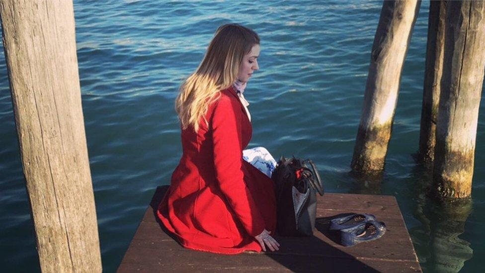 Rachel sitting on a jetty