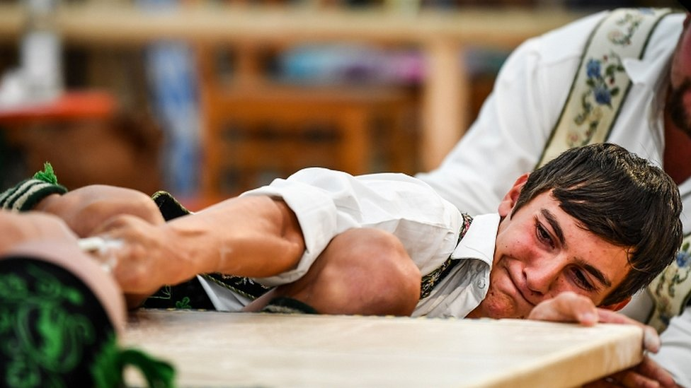 Competitors face off in the German Finger Wrestling (Fingerhakeln) Championships in Garmisch-Partenkirchen, southern Germany, 15 August 2019
