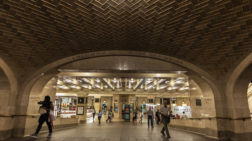 View of the tiled vault in the interior of the Grand Central Terminal in New York USA - with people walking by.