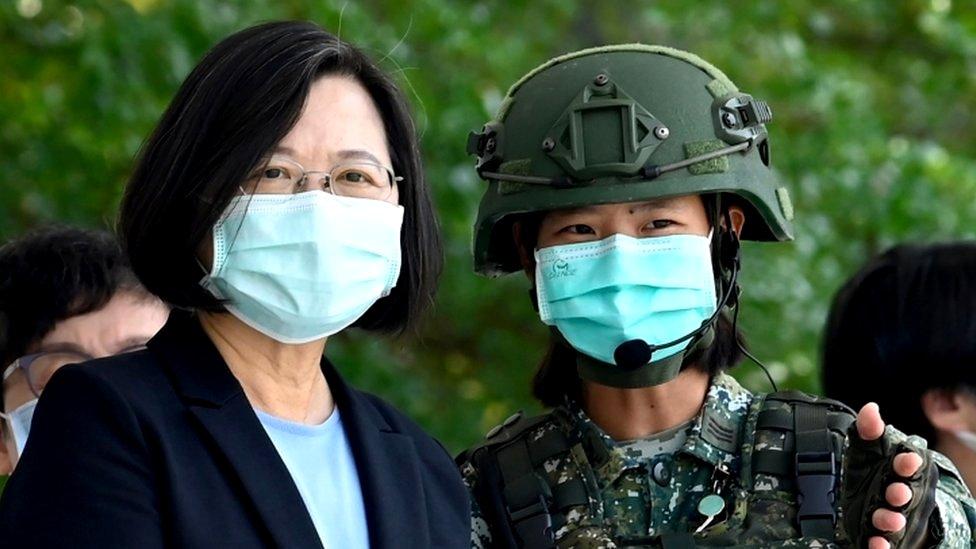 President Tsai Ing-wen (L) on a visit to a military base - 9 April