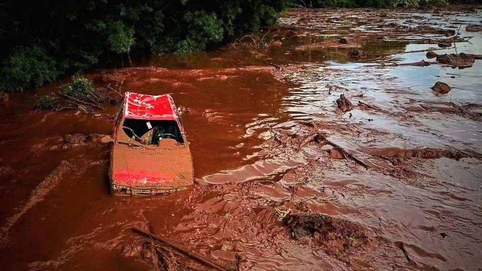 A car in a sea of muddy sludge in Brumadinho