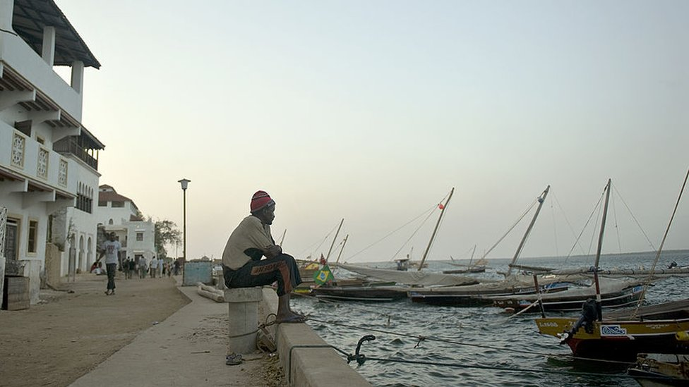 fisherman seated at a moor in Kenya's resort-island of Lamu, over 800 kilometres south-east of Nairobi