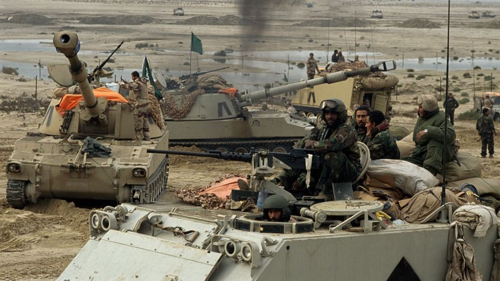 Saudi troops and US Special Forces move toward Kuwait City during the First Gulf War.