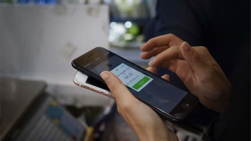 Person makes a payment on their smartphone in China