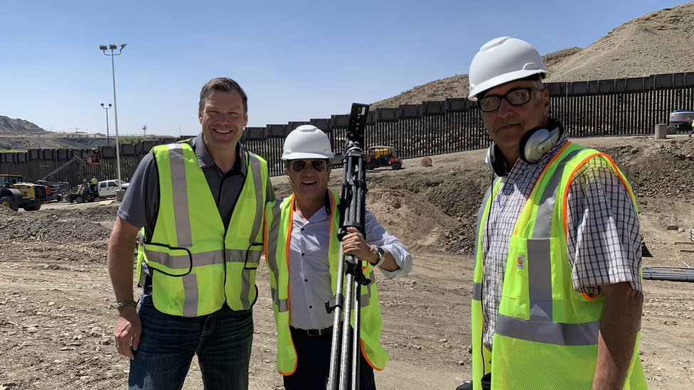 Former Kansas secretary of state Kris Kobach (left) giving tour of construction site