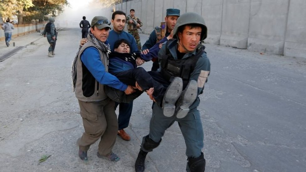 Afghan policemen carry an injured man after the blast in Kabul, Afghanistan 31 October, 2017