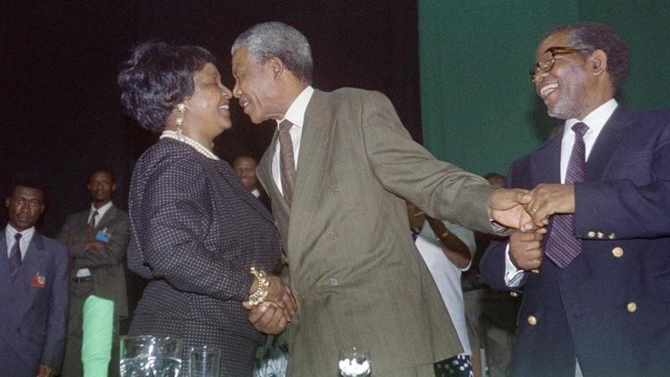 Nelson Mandela and Winnie Madikizela-Mandela kiss after his victory as head of ANC