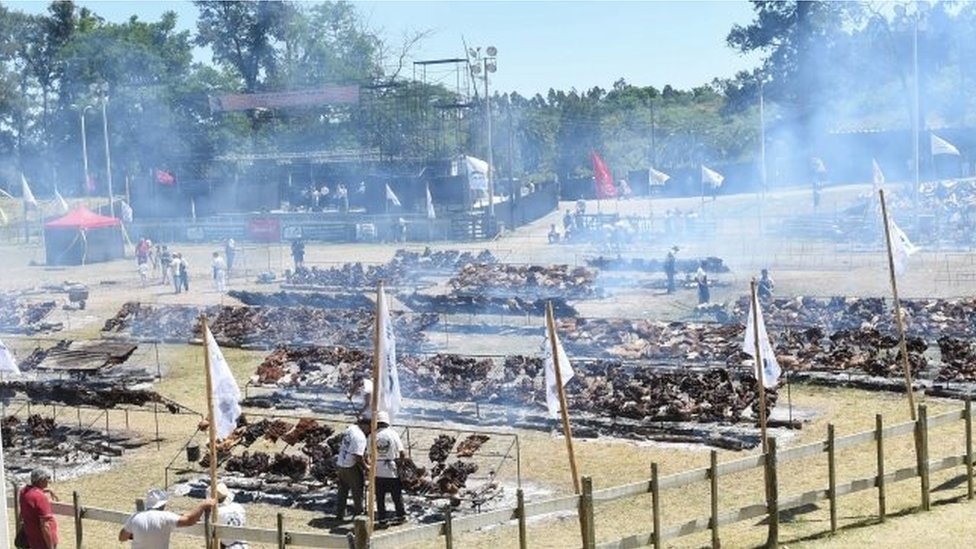 """A total of 16,500 kg of beef are grilled in Rodo Park in Minas, Uruguay, 120 km from Montevideo, in an attempt to break the Guinness record for """"The World"""" s Biggest Barbecue"""", on December 10, 20"""