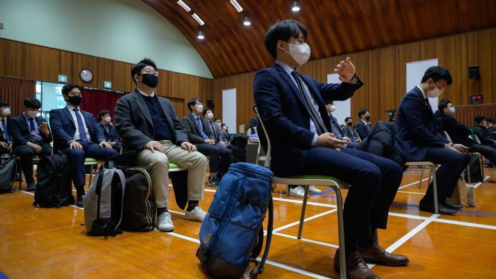 South Korean Jehovah's Witnesses who are conscientious objectors to mandatory military service, await an induction session at a correctional facility where they will begin training as administrators, in Daejeon on October 26, 2020