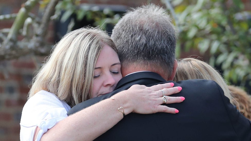 Pc Harper's relatives hug each other