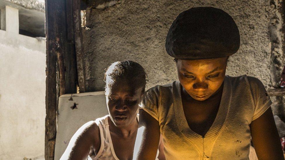 Eking out a living in Haiti's colourful slum city