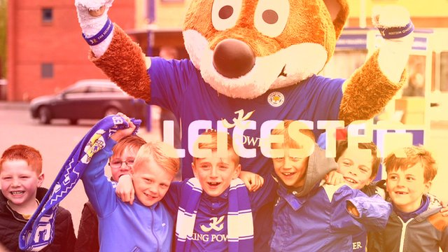 Leicester fans celebrate with the team's mascot.