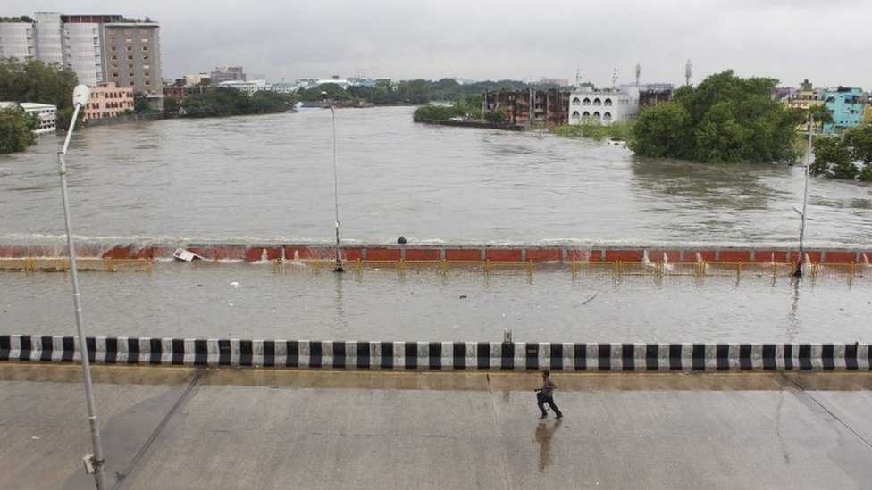 A bridge is submerged in flood waters in Chennai, India, 02 December 2015.