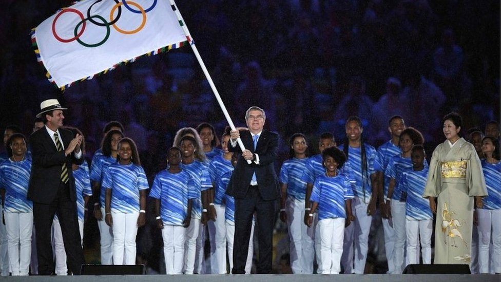Thomas Bach waved the Olympic flag during the closing ceremony of the Rio Olympics, 22 Aug 16