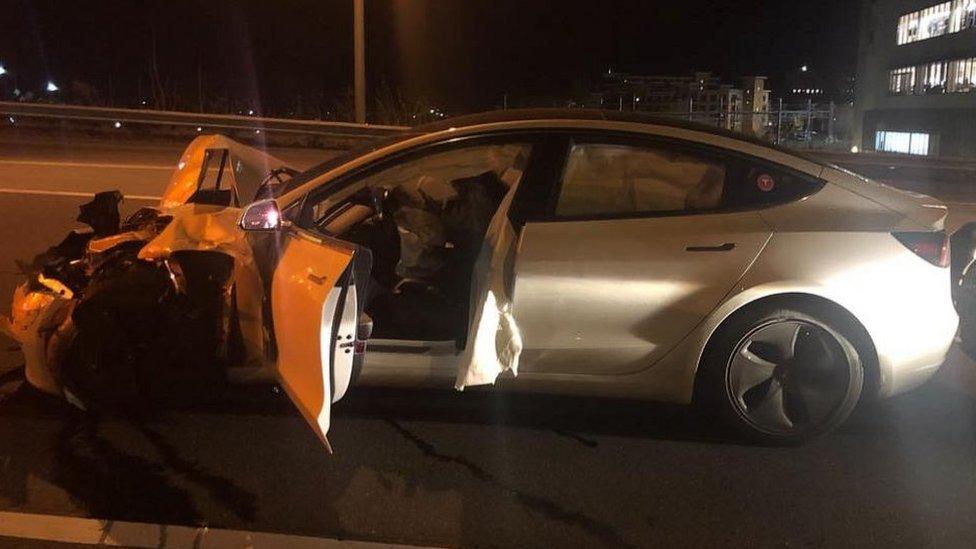 A Tesla Model 3 following a crash with a police car.