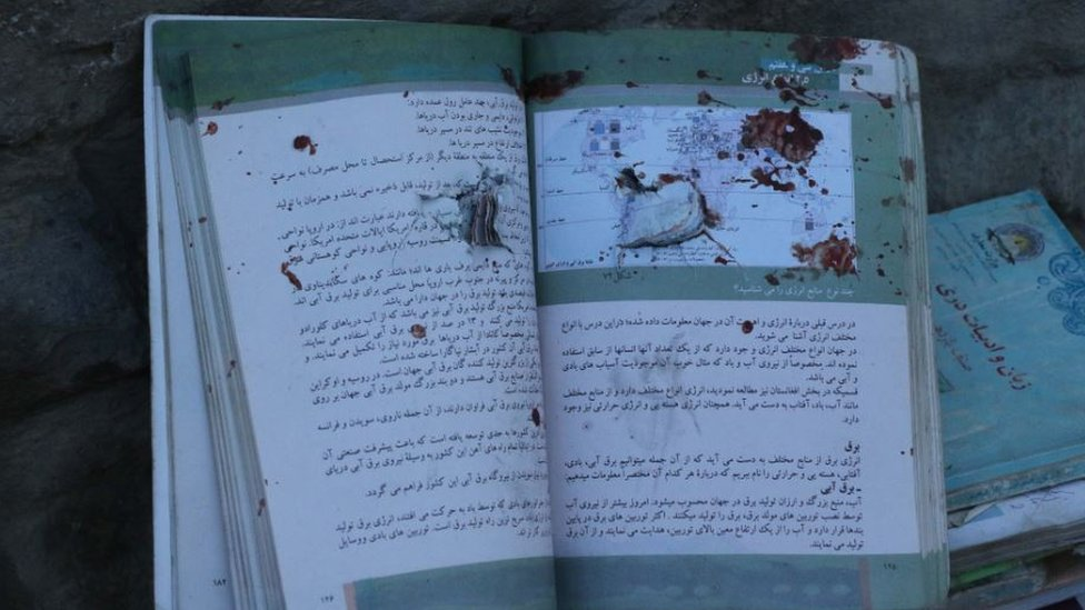 Aftermath of the attack shows blood stained books