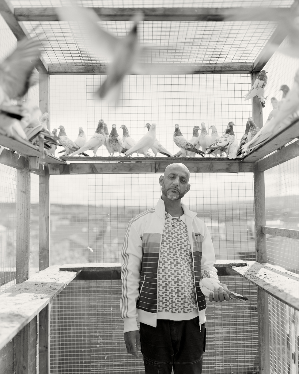 Black and white portrait of a man surrounded by birds