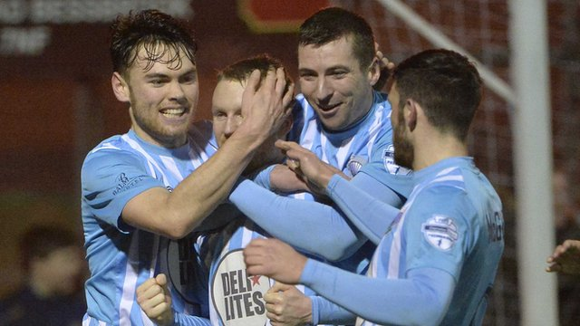 Warrenpoint Town are three points adrift at the bottom after beating Portadown 2-0.