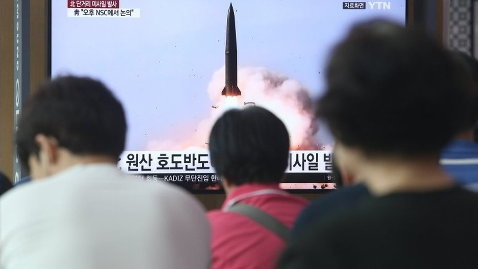 People in Seoul, South Korea, watch breaking news of North Korea's missile launch in July 2019