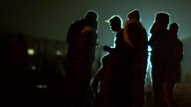 Migrants in silhouette