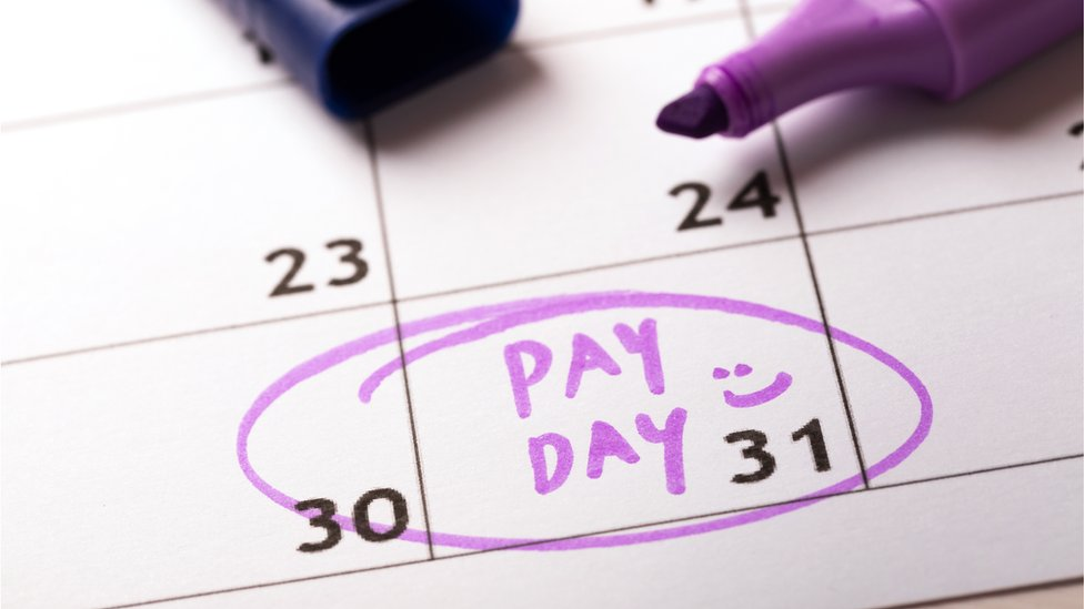 A calendar marked with the words: Pay day