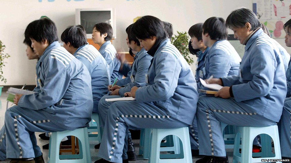 A group of Chinese women prisoners attend a class at the Nanjing Women Prison, in the eastern Chinese city of Nanjing, 07 March 2005