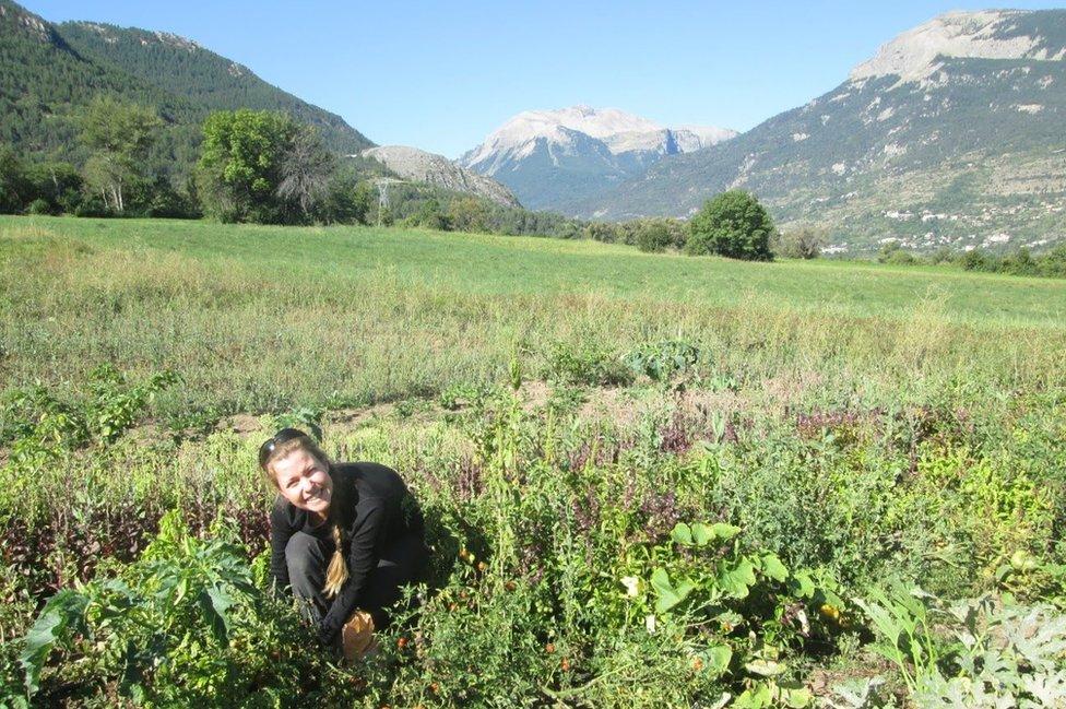 Esther working in field on farm