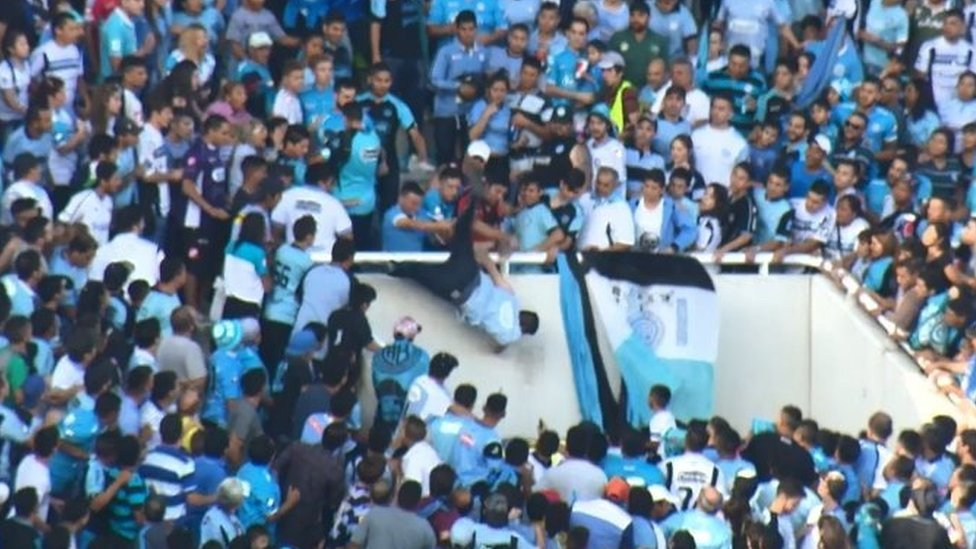 Emanuel Balbo (centre) falls from a stand in Cordoba, Argentina